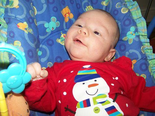 Baby Oscar in a bouncy chair