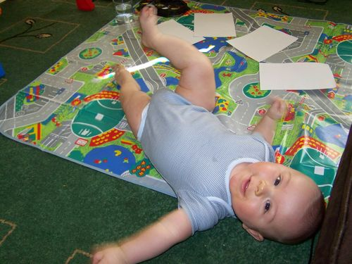 Happy Little Man lying on the playmat before painting
