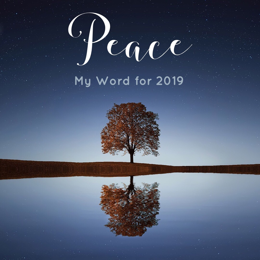 "Image of a tree reflected into a still lake, with the word, ""Peace, my word for the year 2019"""