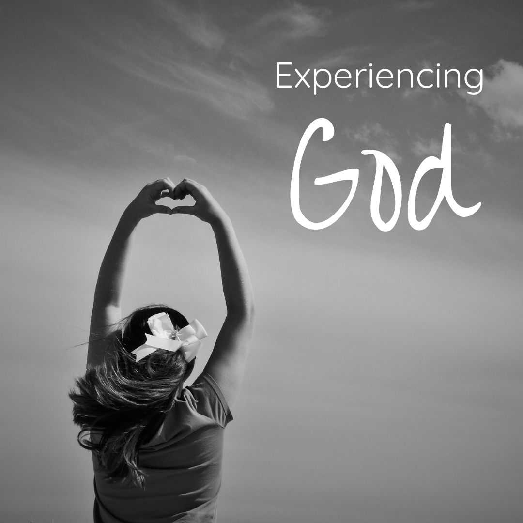 "Black and white image of woman holding arms in the air, her hands in the shape of a heart. The words, ""experiencing God"" are overlaid."