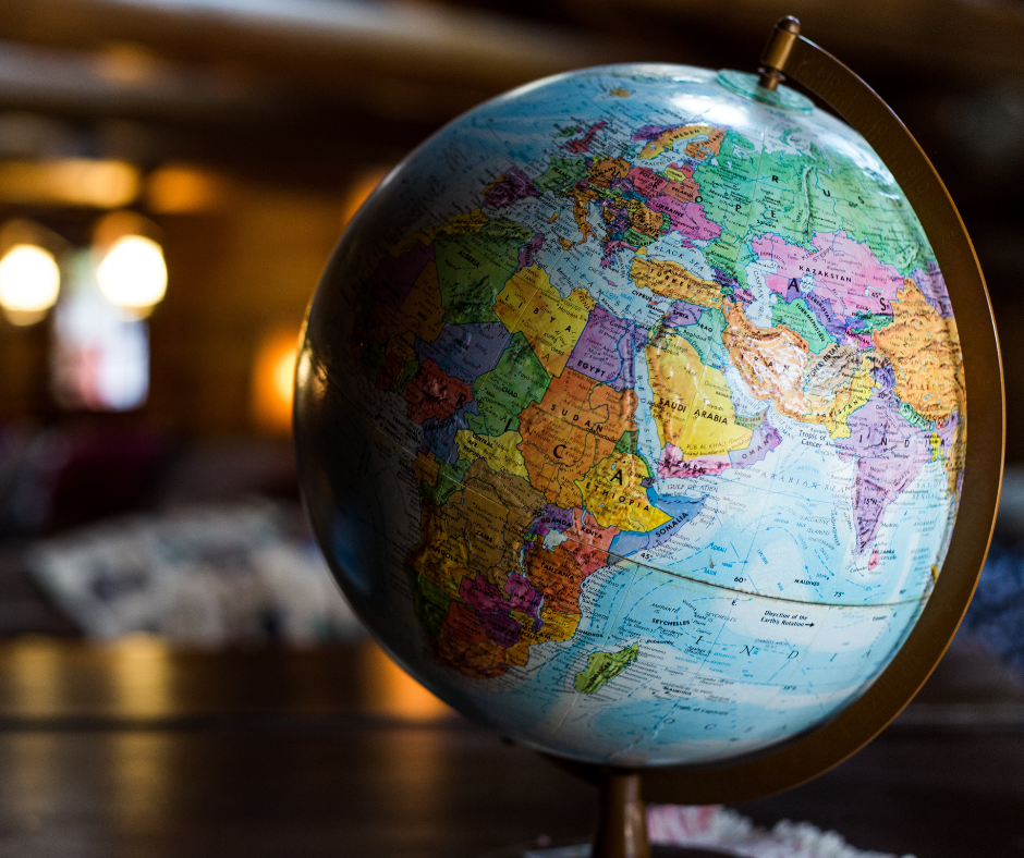 a globe on a desk showing parts of Africa, Asia, and Europe